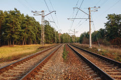 Railway track line leading into unknown Stock Photos