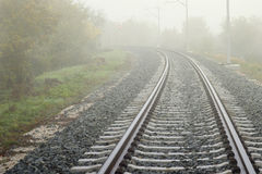 Railway track line in mist Royalty Free Stock Photos