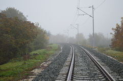 Railway track lines in mist Stock Photography
