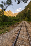 Railway track and Machu Picchu mountains, Peru Royalty Free Stock Images