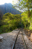 Railway track and Machu Picchu mountains, Peru Stock Photos
