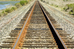 Railway track in north America. A railway track passing through Monterey Bay, California royalty free stock photos