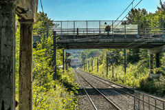 Railway track and overpass. Railway track overpass with trees signs  and blue sky Stock Photo