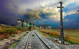 Railway track past engineering plant Royalty Free Stock Photos