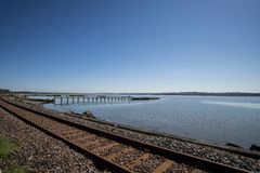 Railway track and pier, Culross, Scotland stock photos