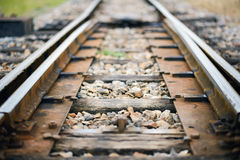 Railway Track. Resting on wooden sleepers surrounded by small stones Royalty Free Stock Image