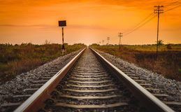 Railway Track in a Rural Scene at Sunrise Time. Stock Image