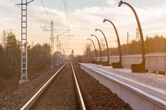 Railway track at a small railroad station Royalty Free Stock Photos