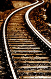Railway track snaking into distance Royalty Free Stock Images
