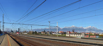 Railway track on Tatra Mountains background. Panoramic view of Railway track on Tatra Mountains background. Slovakia, Eastern Europe Royalty Free Stock Photography