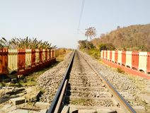 Railway track. Train line with fences both sides of track in Sambalpur, Odisha royalty free stock images