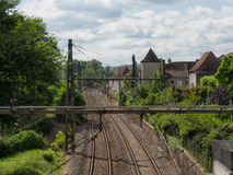 Railway track with a village in France Stock Image