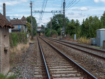 Railway track with a village in France Royalty Free Stock Photos