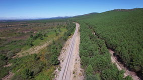 Railway and track in the wilderness, aerial view stock video