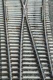 Railway Tracks. Cross-over of railway tracks laid on concrete sleepers Royalty Free Stock Photo