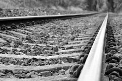 Railway Tracks. Low angle view in black and white Royalty Free Stock Photos
