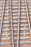 Railway tracks. Rusty railway tracks at station Stock Photo