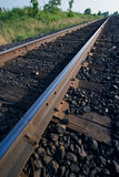 Railway tracks. Single rail tracks receeding into the distance Stock Photos