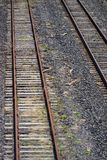 Railway tracks. On ballast bed groundwork in city Stock Images