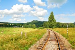 Railway tracks in a beautiful countryside. Landscape royalty free stock photo