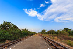Railway tracks with blue sky in the evening Stock Images