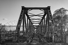The railway tracks on the bridge. Closed entrance to the railway tracks on the bridge Stock Photo
