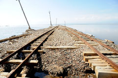 Railway tracks in Caka Salt Lake Royalty Free Stock Photography