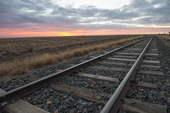 Railway tracks. At dawn in outback, Queensland, Australia royalty free stock images