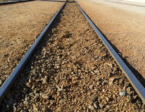 Railway tracks disappearing into the distance. Alpine railway track converging on the horizon Royalty Free Stock Photography