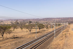 Railway Tracks Dry Landscape. Railway train tracks line travel through dry season rural landscape Stock Images