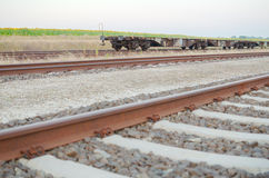 Railway Tracks with Empty Open Wagons Sidewards Stock Photo