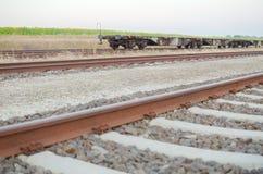 Railway Tracks with Empty Open Wagons Sidewards Stock Photo