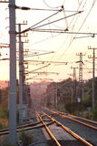 Railway Tracks in Evening Sun. Railway tracks, masts and overhead cables glittering in the setting sun royalty free stock photography