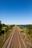 Railway. Tracks from a railway in german near solar panels Royalty Free Stock Image