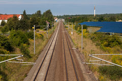Railway. Tracks from a railway in german near solar panels Stock Photo