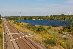 Railway. Tracks from a railway in german near solar panels Stock Image