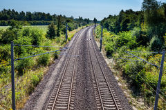 Railway. Tracks from a railway in german near solar panels Stock Photography