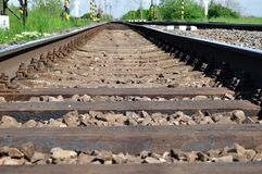 Railway tracks with girder and gravel Stock Image
