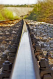Railway tracks and gravel. A local railroad track runs through town Royalty Free Stock Image