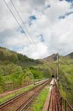 Railway tracks heading towards a tunnel Stock Images