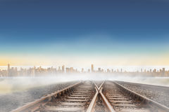 Railway tracks leading to city Royalty Free Stock Photos