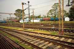Railway tracks lies together and rail coaches behind those. royalty free stock images