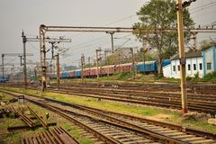 Railway tracks lies together and rail coaches. stock photo