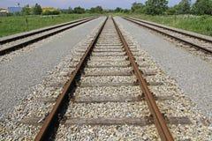 Railway tracks. Looking down the train tracks stock photo