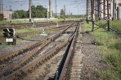 Railway Tracks at a Major Train Station at Sunset. Royalty Free Stock Photo