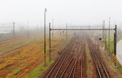 Railway tracks at mist. Royalty Free Stock Photo