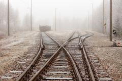 Railway tracks in the mist. Railway tracks on a cold and foggy October morning Stock Photo