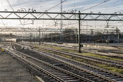 Railway tracks in morning sun at the Dutch station of The Hague Royalty Free Stock Photography