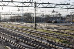 Railway tracks in morning sun at the Dutch station of The Hague Royalty Free Stock Photo