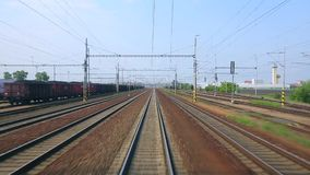 Railway tracks motion. Train journey viewed from the back stock video footage
